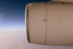 The view of the Antarctic ice and one of the Ilyushin's jet engines out the one small window of the aircraft