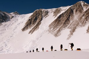 The teams moving to Low Camp with Vinson high above