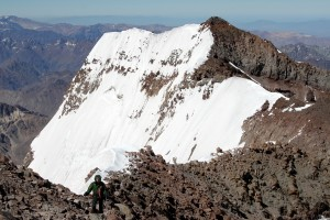 Kristine almost to Aconcagua's higher north summit with the south summit and 10,000' south face behind