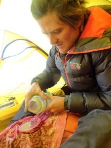 Filtering water at Camp 2 utilizing a bandana