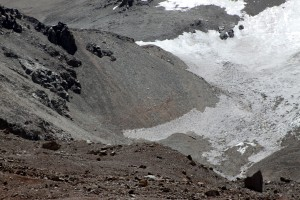 Camp 1 sits atop the shelf at the upper part of the picture after a grueling 1,000' foot scree slog up the slope below