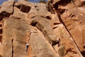 Eric on the 5.8 dihedral (left) while Zac loads up for the 5.9 layback crack (right)