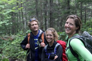 Rob, MK, & Kristine in good spirits on the hike out to the car despite the rain and cold