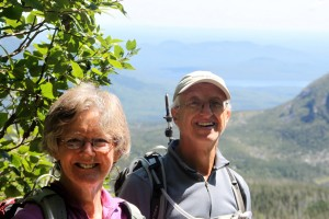Dianne & Ken taking a break on the steep Saddle Trail with a gorgeous backdrop