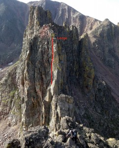 Me scrambling up Capricorn's south ridge with our rappel ledge and rappel route off Cancer show behind