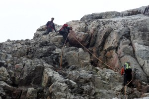 The boys descending the fixed ropes below the Lower Saddle
