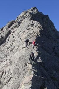 The boys downclimbing off Little Bear's northeast ridge