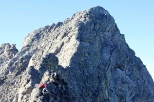 Derek on an airy move with Little Bear Peak behind