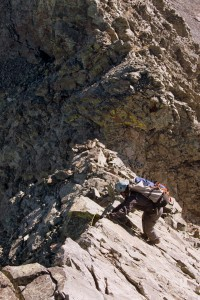 J downclimbing a knife-edge ridge of another tower