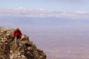 Derek on the summit ridge of the 3rd tower with the San Luis Valley over 7,000' below