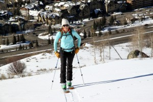 Kristine starting the skin with the Vail Village exit down below