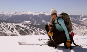 Kristine & Kona on Bald Mountain's summit with Vail ski resort and the northern Sawatch Range behind