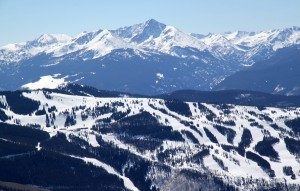 Vail ski resort with 14er Mt. of the Holy Cross in the distance as seen from Bald Mountain's summit