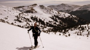 Jake skinning along with Copper Mountain ski resort behind