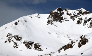 The Citadel (13,294') as seen from upper Herman Gulch. Two parties can be seen - one down lower in the center of the photo and another traversing towards Snoppy's Backside Chute