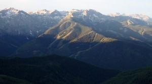 The tops of the Telluride ski mountain and surrounding peaks waking up