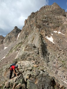 Jason beginning the scramble up Peak R with Peak Q dominating the landscape behind