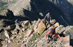 The boys scrambling up to the knife-edge ridge