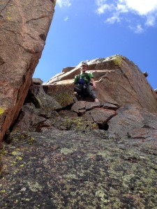 Me at the top of the low 5th class hand-jam crux