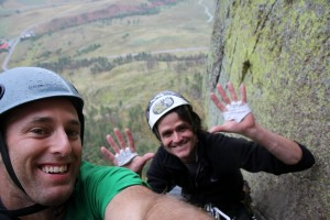 J & I at the hanging belay of Soler when it started to rain harder
