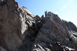 Downclimbing the crux of the east ridge of Eagle's Nest