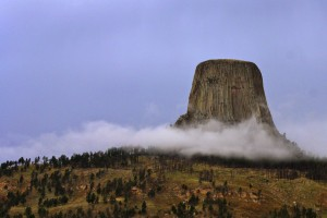 Devil's Tower surrounded by low clouds. Photo by Derek