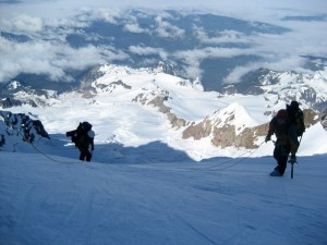 Matt & Steve climbing the Tahoma Glacier headwall with the lower Tahoma Glacier far below which we ascended