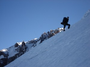 Me climbing the Tahoma Glacier headwall with Liberty Cap behind me