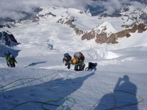 Belaying Nico up the narrow snow bridge
