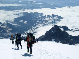 Descending the upper Ingraham Glacier with Little Tahoma Peak in the background