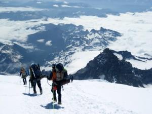 Descending the upper Ingraham Glacier with Little Tahoma Peak in the background