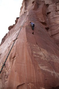 Ryan climbing the initial fun 30' of arcing finger crack before the face climbing on Out of the Frying Pan Into the Fire