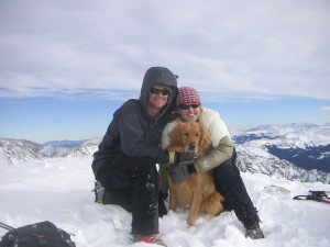 A friendly Kristine & Brandon with a young Rainier on the summit of Huron Peak in November 2006