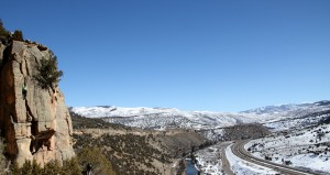 Wide angle of Kristine on Arrow, snow-covered hills, and the always beautiful I-70
