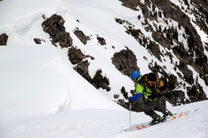 Joel skiing the steep headwall pitch