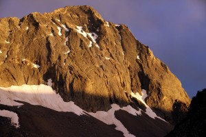Alpenglow on capitol's north face. The Northwest Buttress route is the right skyline