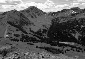 Descending Red Peak's south ridge to Red Buffalo Pass (left) with Deming Mountain and West Deming in the distance