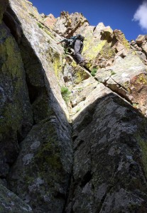 Me climbing the dihedral. Photo by J