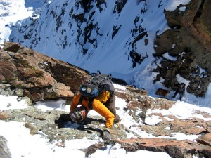 Me downclimbing the class 4 headwall to the notch below where Mikey & Rainier wait