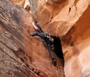 Me making the crux off-width move to the anchors on Rusty's Cave