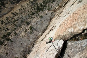 Kristine climbing the 5.8 pitch 3