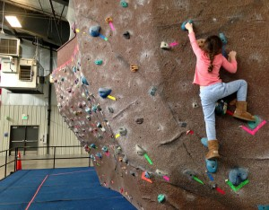 Harper on the WECMRD bouldering wall in her UGGs!