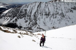 Kristine high in the couloir with Northstar Mtn behind