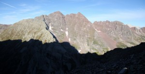 First view of the Maroon Bells from the small saddle at 12,700' on Pyramid's NW ridge