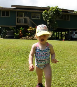 Sawyer on the way to Tunnels Beach with the front of our house behind