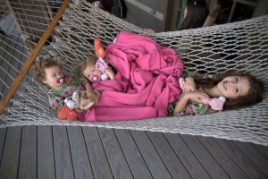 Cuzins lounging on the back porch hammock