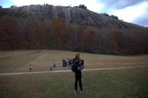 Kristine approaching Stone Mountain's south face. The Great Arch is the obvious dihedral up the center of the face