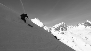 Ben capturing Brian ripping turns down the north side of West Booth Pass with The Spider and The Fly as a backdrop