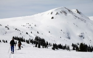 Skinning up to the ridge with Gold Hill behind