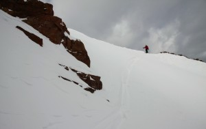 Derek traversing the steep, upper slope over to J and I on the couloir's right side